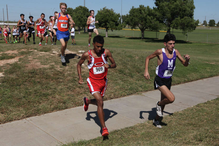 Midland High's Lorenzo Mendez (right) competes during the District 2-6A Cross Country Championships on Thursday at UTPB Park. Jacob Ford/Odessa American