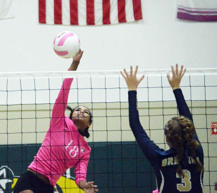 Metro-East Lutheran's Ellen Schulte, left, goes up for a kill with Father McGivney's Anna McKee trying to block it in the second game on Thursday at MELHS.