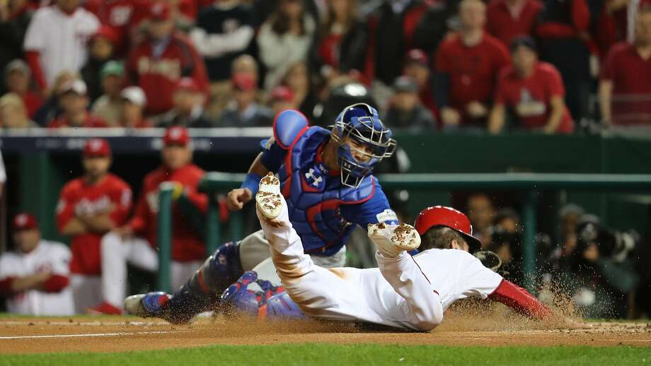 Chicago Cubs catcher Willson Contreras tags out the Washington Nationals' Trea Turner sliding at home plate in the first inning in Game 5 of the National League Division Series on Thursday, Oct. 12, 2017, at Nationals Park in Washington, D.C. (Brian Cassella/Chicago Tribune/TNS) Photo: Brian Cassella, TNS