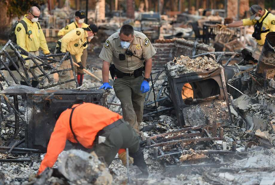 A search and rescue team searches for bodies at a property where a person was reported missing in Santa Rosa, California on October 12, 2017. Hundreds of people are still missing in massive wildfires which have swept through California killing at least 26 people and damaging thousands of homes, businesses and other buildings. Photo: JOSH EDELSON, AFP/Getty Images