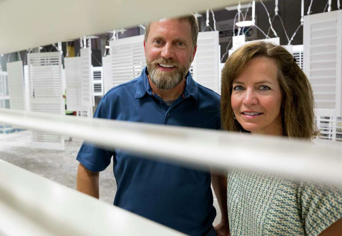Rockwood Shutters COO Michael Blackburn, left, and president and CEO Jennifer Baur pose for a photograph inside the assembly line Monday, Oct. 9, 2017, in Houston.