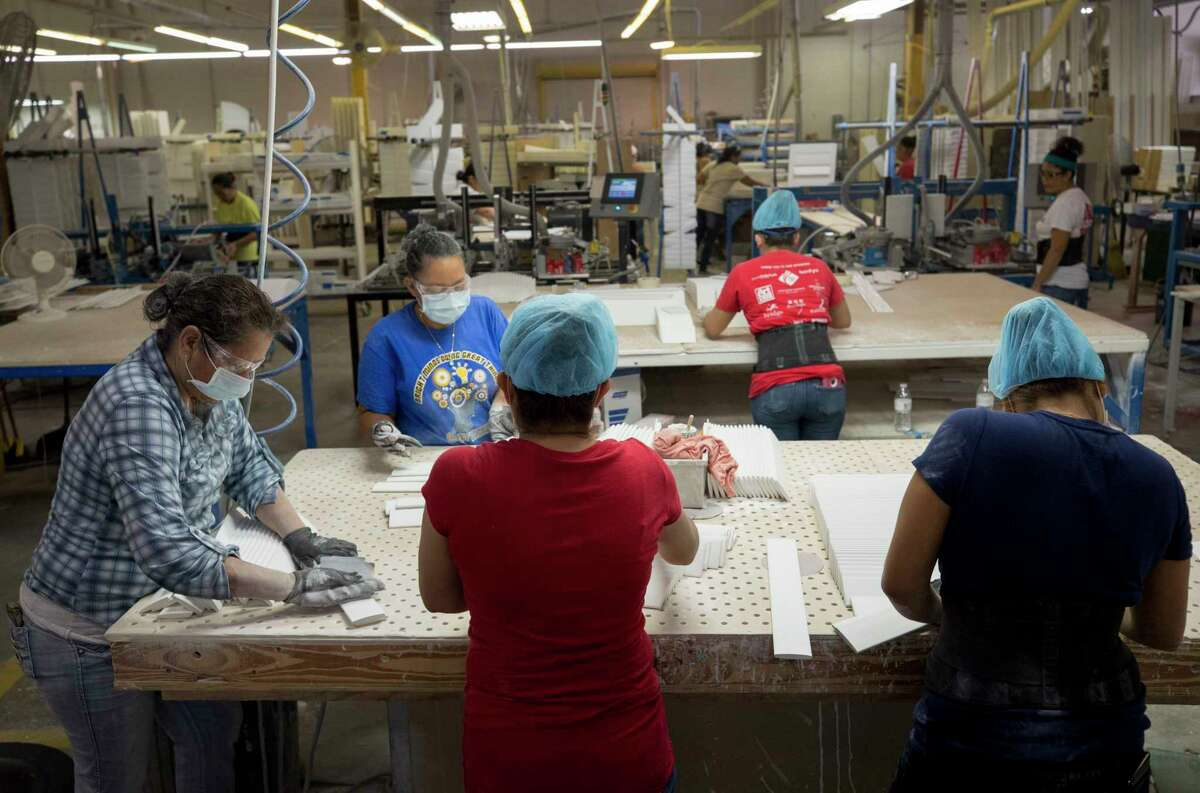 Rockwood Shutters employees work along the assembly line Monday, Oct. 9, 2017, in Houston.