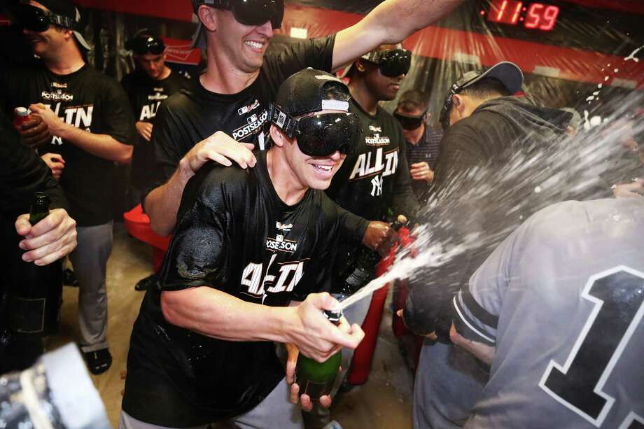CLEVELAND, OH - OCTOBER 11:  The New York Yankees celebrate in the locker room after their 5 to 2 win over the Cleveland Indians in Game Five of the American League Divisional Series at Progressive Field on October 11, 2017 in Cleveland, Ohio.  (Photo by Gregory Shamus/Getty Images) ORG XMIT: 775053732 Photo: Gregory Shamus / 2017 Getty Images