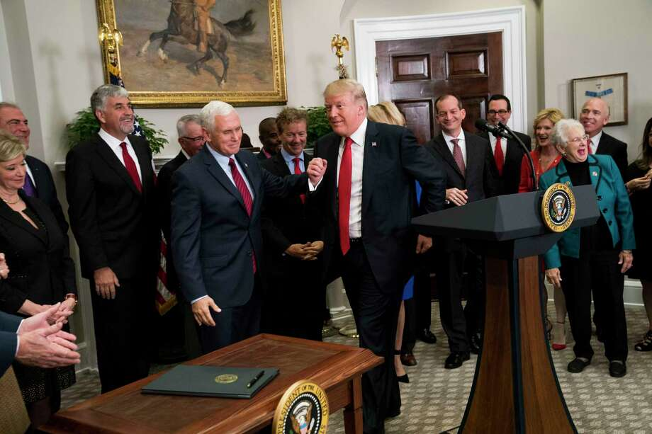 President Donald Trump pretends to jog back toward the singing table after almost leaving the room before signing an executive order that clears the way for potentially sweeping changes in health insurance, during an event attended by small-business owners and others at the White House, in Washington, Oct. 12, 2017. (Doug Mills/The New York Times) Photo: DOUG MILLS / NYTNS