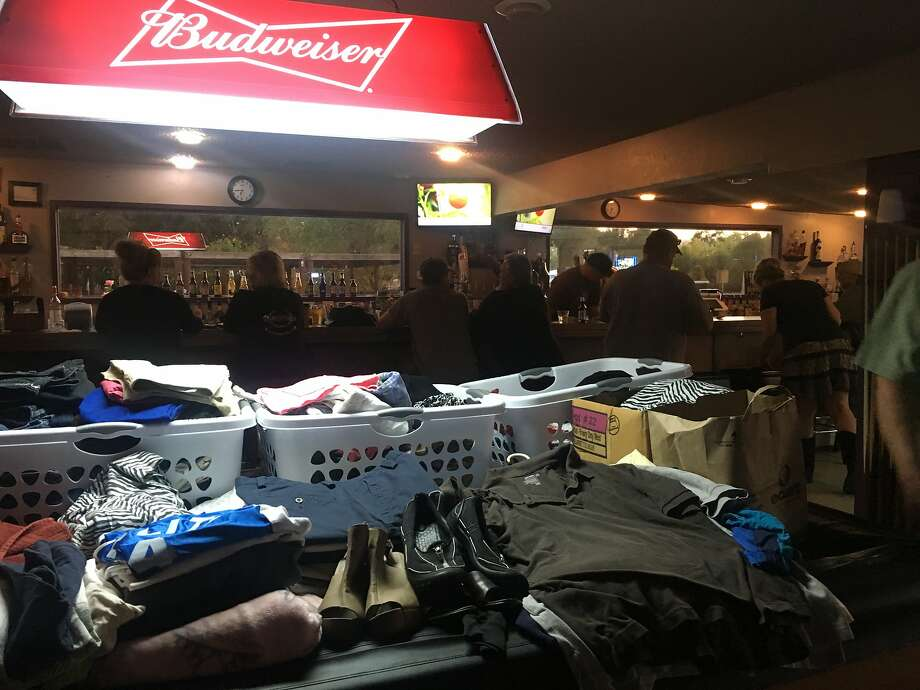 McCarty's Bar in Redwood Valley in Mendocino County, where supplies are being dropped off for people driven from their homes by the Redwood Fire that has burned more than 30,000 acres north of Ukiah. Some evacuees are even sleeping at McCarty's after it closes for the night. Photo: Trisha Thadani