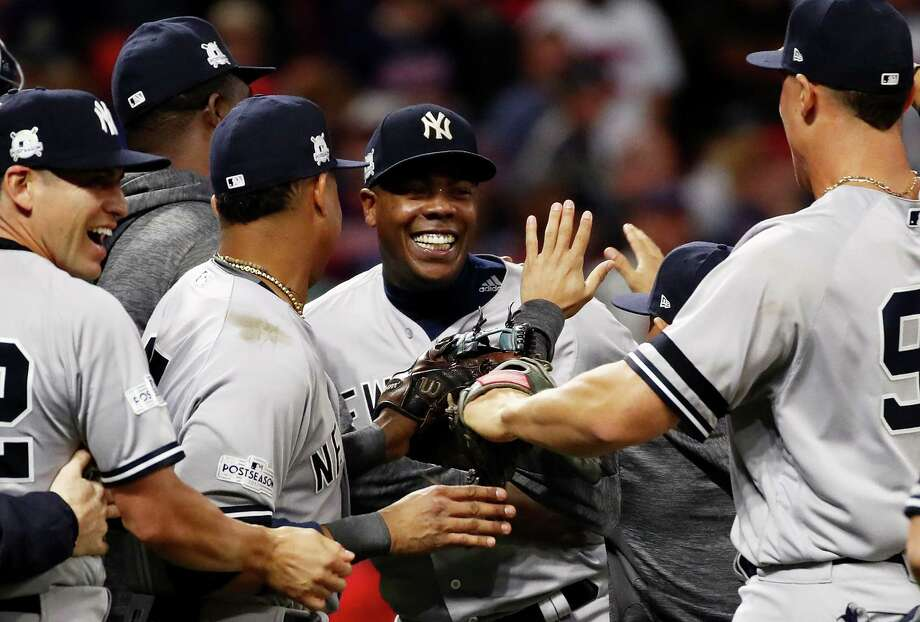 CLEVELAND, OH - OCTOBER 11:  Aroldis Chapman #54 of the New York Yankees celebrates with teammates after their 5 to 2 win over the Cleveland Indians in Game Five of the American League Divisional Series at Progressive Field on October 11, 2017 in Cleveland, Ohio.  (Photo by Gregory Shamus/Getty Images) ORG XMIT: 775053732 Photo: Gregory Shamus / 2017 Getty Images