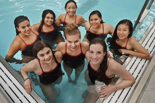 Cheshire seniors Stephanie Silin, Jordyn Deubel, Liz Boyer, team captains, left to right in the front row and Lexi Tejeda, Serena Patel, Amanda Go, Lizeth Morales and Jessica Tan following their meet against Amity, Thursday, Oct. 12, 2017, at the Cheshire Community Pool. Cheshire won, 101-82. The seniors have been unbeaten in the regular season for all four years.