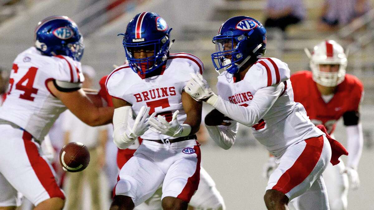 Beaumont West Brook running back James Jones (5) fumbles the exchange from quarterback La'92Ravien Elia (3) during the first quarter of a District 12-6A high school football game at Woodforest Bank Stadium on Thursday, Oct. 12, 2017, in Shenandoah.