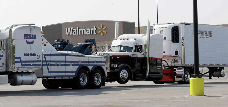 A Pyle Transportation-branded semitrailer, right, is towed from the lot of a San Antonio Walmart. Ten of the immigrants inside died. Photo: Eric Gay, STF / Copyright 2017 The Associated Press. All rights reserved.