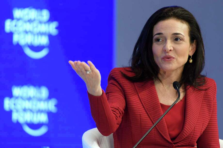 """FILE - In this Wednesday, Jan. 18, 2017, file photo, Facebook Chief Operating Officer Sheryl Sandberg speaks during a plenary session during the annual meeting of the World Economic Forum in Davos, Switzerland. Sandberg says the ads linked to Russia trying to influence the U.S. presidential election should """"absolutely"""" be released to the public. In an interview with Axios, Thursday, Oct. 12, 2017, Sandberg also said the company has the responsibility to prevent the kind of abuse that occurred on its platform during the election. (Laurent Gillieron/Keystone via AP, File) Photo: Laurent Gillieron, SUB / © KEYSTONE / LAURENT GILLIERON"""