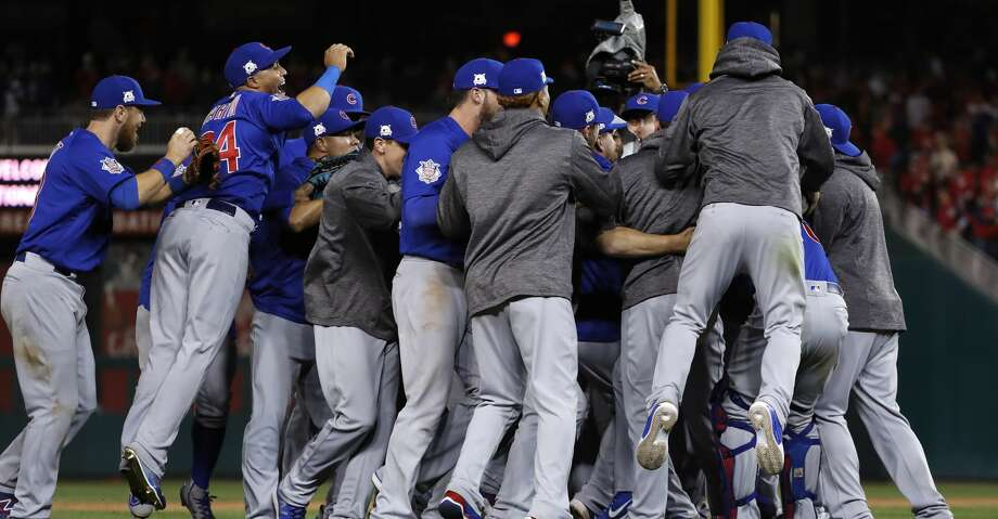 The Chicago Cubs celebrate after beating the Washington Nationals 9-8 to to win baseball's National League Division Series, at Nationals Park, early Friday, Oct. 13, 2017, in Washington. (AP Photo/Pablo Martinez Monsivais) Photo: Pablo Martinez Monsivais/Associated Press
