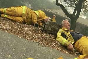 Kiara Evan shared this photo of exhausted first responders taking a break while fighting the Wine Country fires.