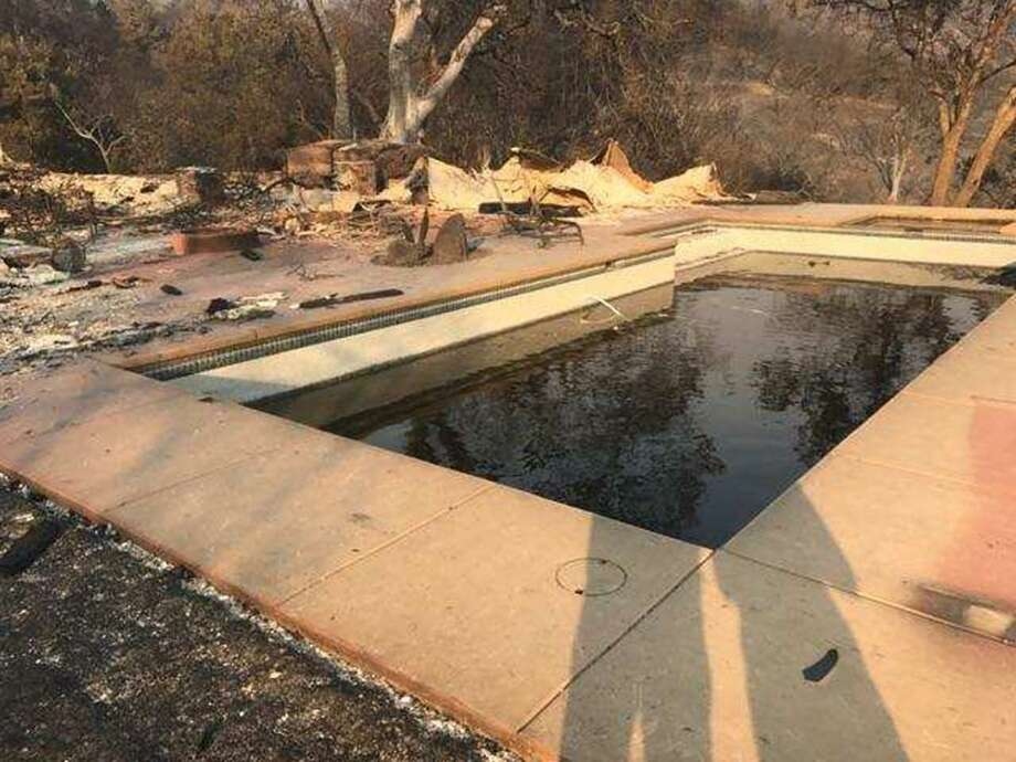 For hours, Armando and Carmen Berriz held each other in this pool, trying to survive as the flames closed in around them. Photo: Courtesy Berriz Family
