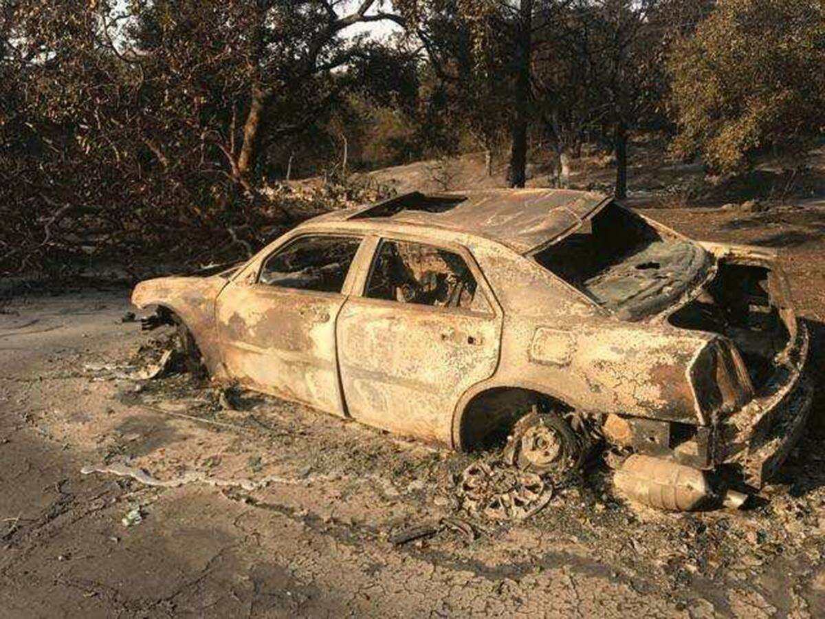 Armando and Carmen Berriz tried to flee Santa Rosa in this automobile. They were trapped and tried to wait out the blaze in a pool.