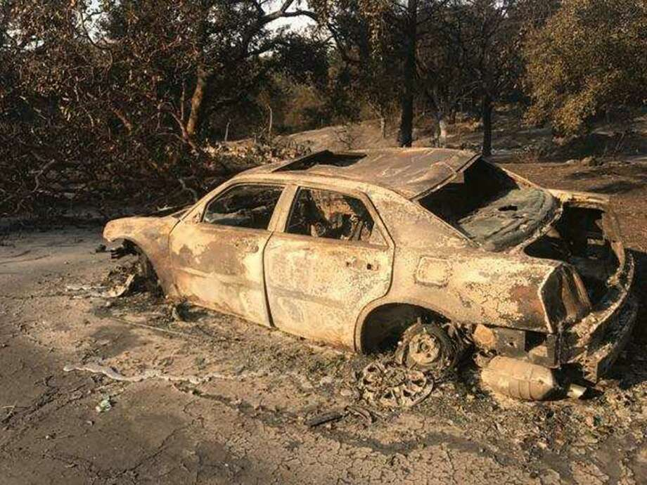 Armando and Carmen Berriz tried to flee Santa Rosa in this automobile. They were trapped and tried to wait out the blaze in a pool.  Photo: Courtesy Berriz Family