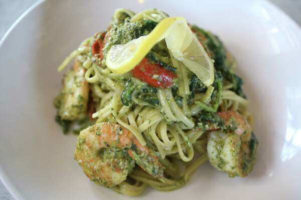 Texas Pecan Pesto Pasta with Shrimp is part of the farm-to-table concept at Dish Society 12525 Memorial Dr. Thursday, Oct. 12, 2017, in Houston.