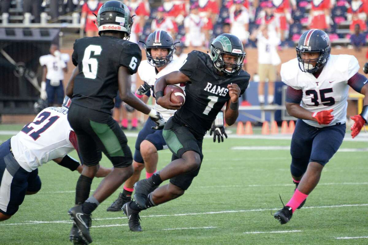 Quarterback Keyonte Fiakpui (1) of Mayde Creek runs for a first down in the first quarter of a high school football game between the Mayde Creek Rams and the Tompkins Falcons on October 12, 2017 at Rhodes Stadium, Katy, TX.