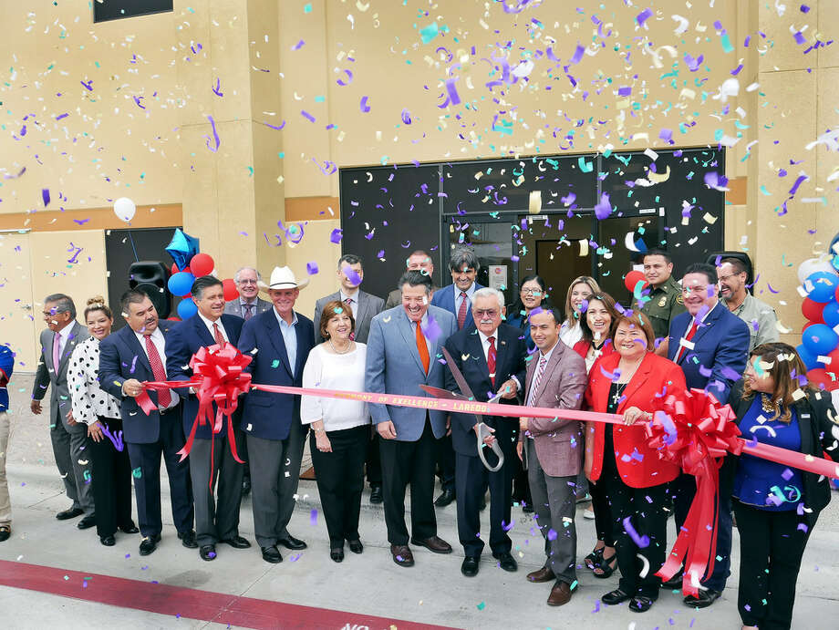 Local and state officials join forces with Harmony Public Schools officials for the ribbon cutting ceremony for Laredo's newest high school, Harmony School of Excellence on Thursday. See related story on A3 Photo: Cuate Santos/Laredo Morning Times
