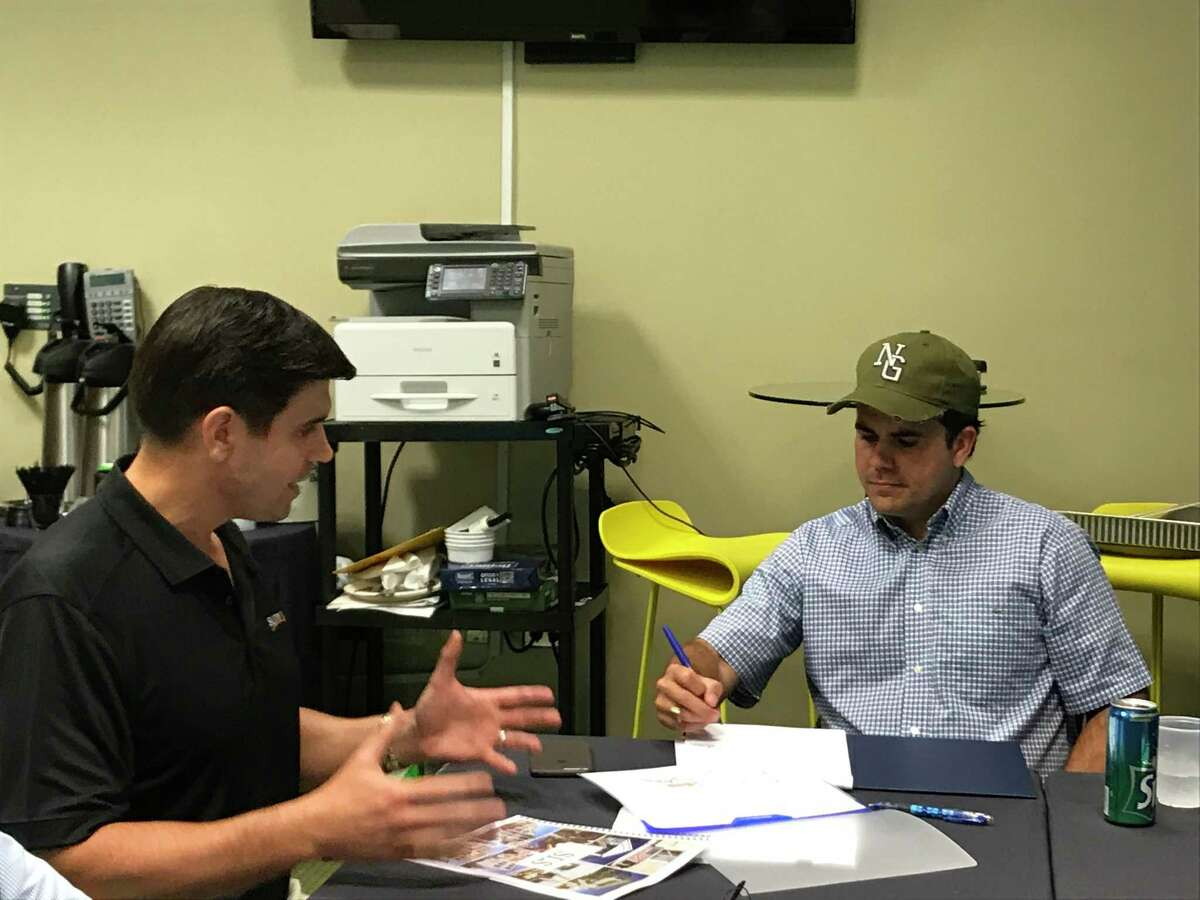 Sunnova CEO John Berger, left, talks with Puerto Rican Gov. Ricardo Rosselló about his Houston-based companies effort with solar and battery systems to alleviate the sweeping power outage caused by Hurricane Maria.