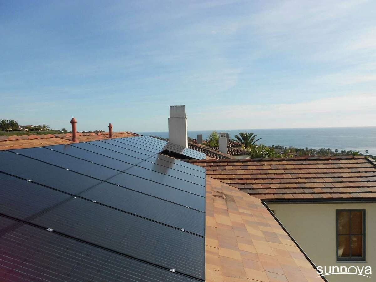 Sunnova arranges for installation of solar panels on customers' roofs, like this one in California, but owns the panels and sells power to the homeowner.