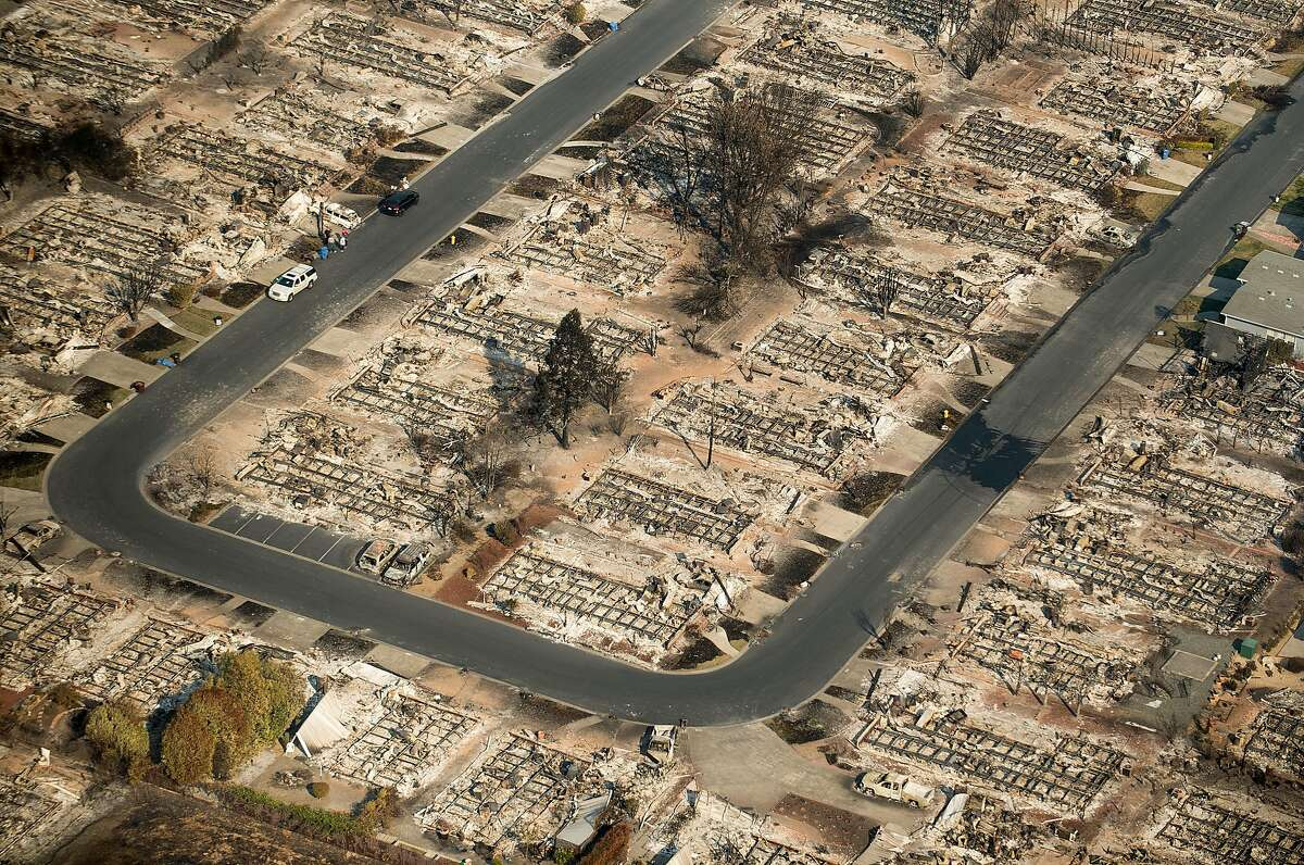 Homes leveled by the Tubbs fire line a neighborhood of Santa Rosa, Calif., on Wednesday, Oct. 11, 2017.