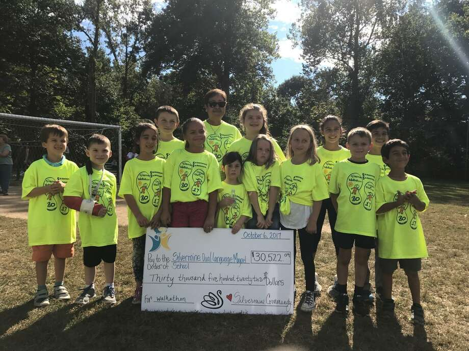 Ivette Ellis, principal of Silvermine Dual Language Magnet School, poses with the top 13 fundraisers in the school's annual walkathon on Oct. 6, 2017. Photo: Contributed Photo