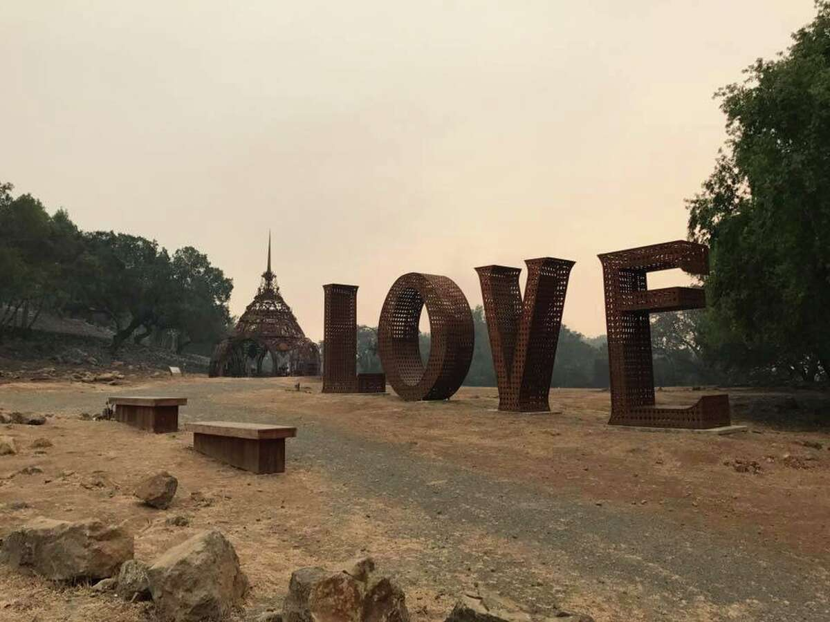 """The """"Love"""" sculpture at Paradise Ridge Winery was singed but otherwise not damaged by the Tubbs Fire, which leveled the Santa Rosa winery.Peter Byck, whose brother, Rene, runs the winery said, """"The temple behind the 'Love' sculpture is the temple of remembrance, which is to remember those we've lost."""""""