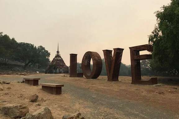 "The ""Love"" sculpture at Paradise Ridge Winery was singed but otherwise not damaged by the Tubbs Fire, which leveled the Santa Rosa winery. Peter Byck, whose brother, Rene, runs the winery said, ""The temple behind the 'Love' sculpture is the temple of remembrance, which is to remember those we've lost."""