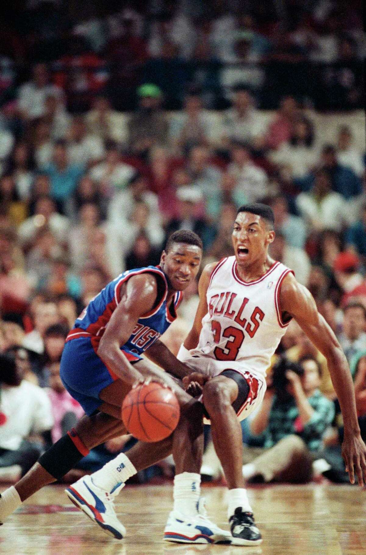 Chicago?s Scottie Pippen, right, heads for the floor as Detroit?s Isiah Thomas pushes off to grab a loose ball during the first quarter of Game 4 during the Eastern Conference finals in Chicago on Sunday, May 28, 1990. (AP Photo/Jim Mone)