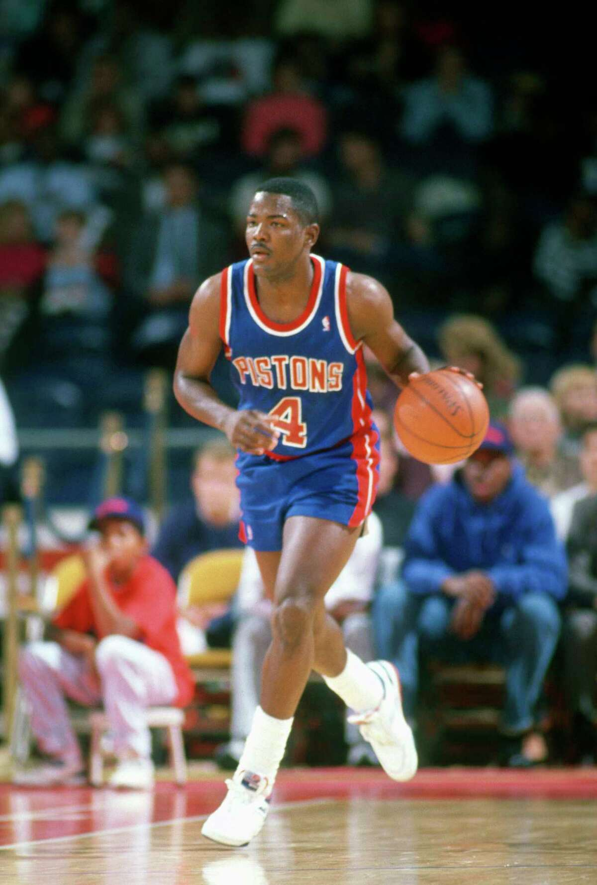 LANDOVER, MD - CIRCA 1990: Joe Dumars #4 of the Detroit Pistons dribbles the ball up court against the Washington Bullets during an NBA basketball game circa 1990 at The Capital Centre in Landover, Maryland. Dumars played for the Pistons from 1985-99. (Photo by Focus on Sport/Getty Images)