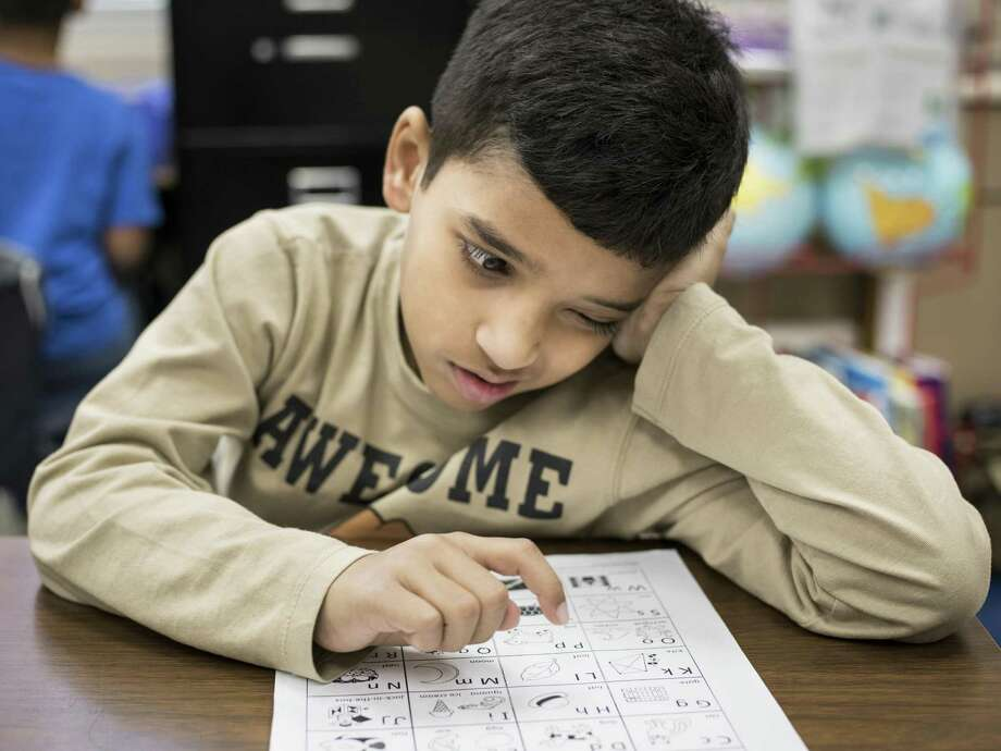 First grader Bilal Zahaid, who speaks Urdu as his first language, studies a sheet of English letters during his English as a Second Language class at Glenoaks Elementary in 2016. Northside ISD is the district with the highest refugee and non-Spanish speaking ESL students in San Antonio. At Glenoaks Elementary, 13 percent of students speak either Arabic, Telugu or Tamil. Photo: Matthew Busch /For The San Antonio Express-News / © Matthew Busch