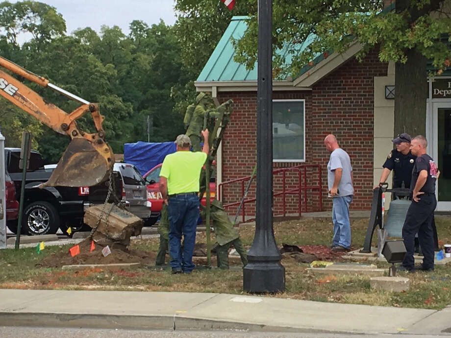 The firefighter statue outside of Edwardsville Fire Station 1 was dug up recently and will be moved to a permanent site at the new public safety facility, which is currently under construction on South Main Street. Photo: John Sommerhof • Jsommerhof@edwpub.net