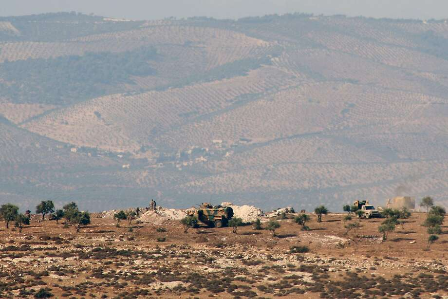 Turkish troops position on a hill in the Syrian border town of Salwah. Turkish vehicles were escorted by al Qaeda fighters, suggesting Ankara's main focus is to deter Kurdish forces. Photo: OMAR HAJ KADOUR, AFP/Getty Images