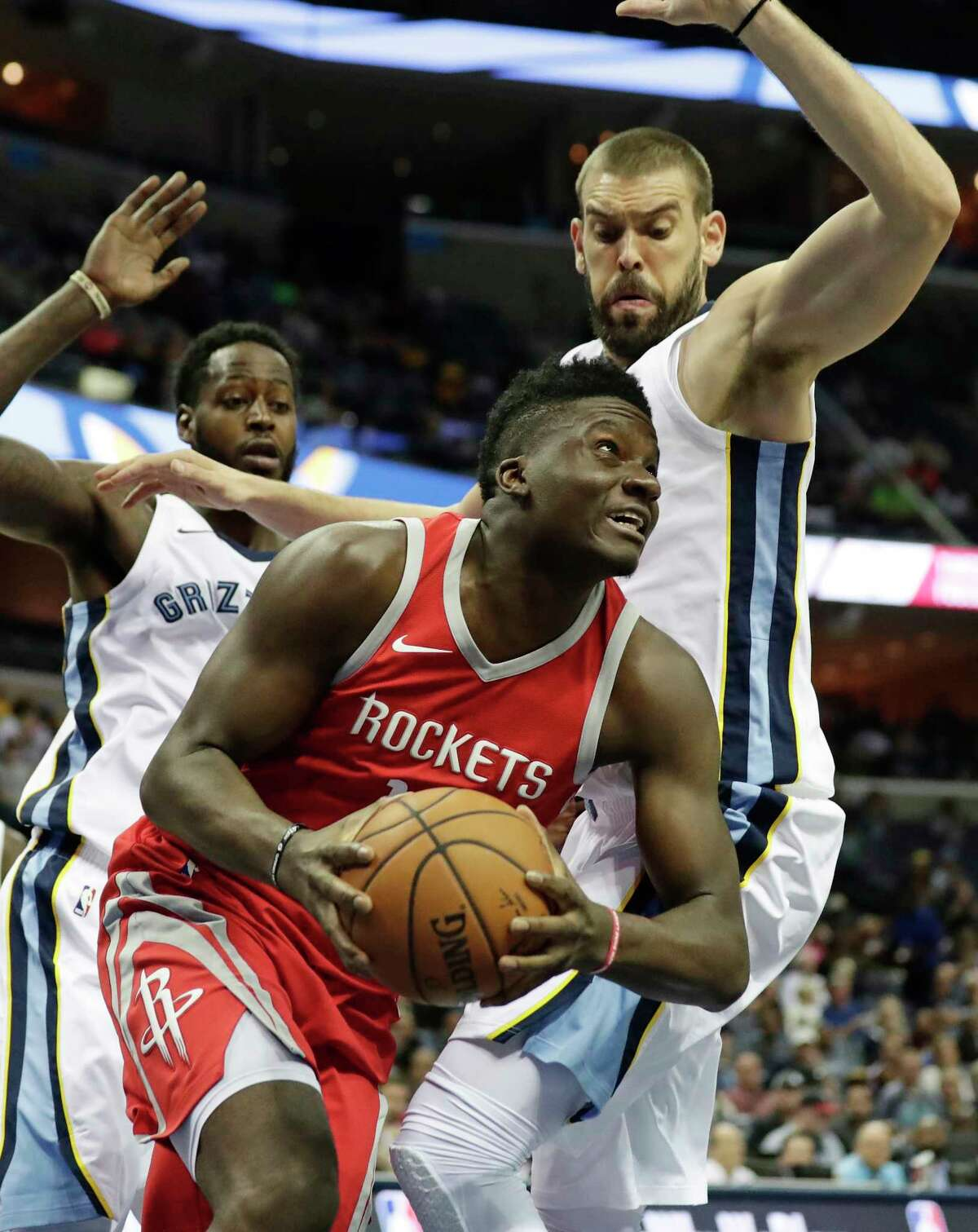 Houston Rockets center Clint Capela (15) tries to find an opening against Memphis Grizzlies center Marc Gasol (33) in the first half of an NBA preseason basketball game on Wednesday, Oct. 11, 2017, in Memphis, Tenn. (AP Photo/Rogelio V. Solis)