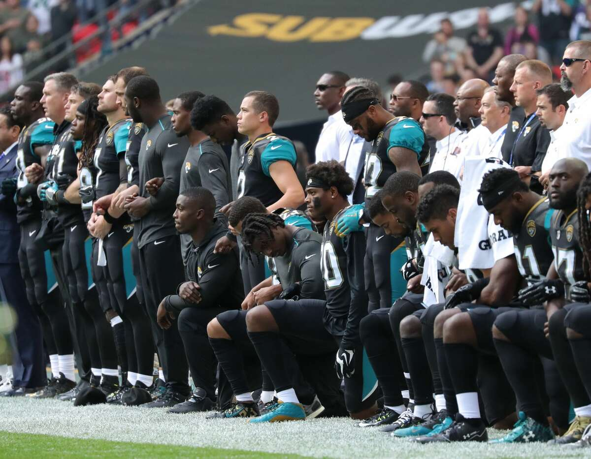 LONDON, ENGLAND - SEPTEMBER 24: Jacksonville Jaguars players kneel during the playing of the national anthem against the Baltimore Ravens at Wembley Stadium on September 24, 2017 in London, United Kingdom. (Photo by Mitchell Gunn/Getty Images)