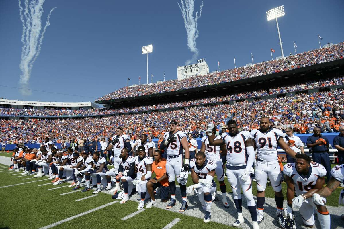 ORCHARD PARK, NY - SEPTEMBER 24: Denver Broncos team take a knee during the national anthem during their game against the Buffalo Bills on September 24, 2017 at New Era Field in Orchard Park, NY. (Photo by John Leyba/The Denver Post via Getty Images)