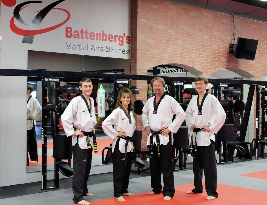 The Battenberg family poses in their new Battenberg's Martial Arts and Fitness facility on Wednesday, Oct. 11. This year marks their business' 30th year in Kingwood. From left to right: Skye Battenberg, Renee Battenberg, Jeff Battenberg, Chance Battenberg. Photo: Melanie Feuk