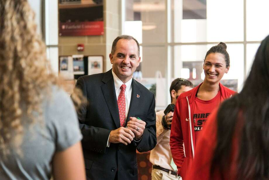 Paul Schlickman, the new athletic director at Fairfield University, meets with some student-athletes. Photo: Contributed Photo