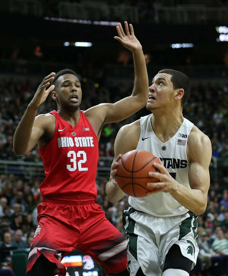 EAST LANSING MI - MARCH 5: Gavin Schilling #34 of the Michigan State Spartans drives the ball to the basket as Trevor Thompson #32 of the Ohio State Buckeyes defends during the second half of the game on March 5, 2016 during the game at the Breslin Center in East Lansing, Michigan. The Spartans defeated the Buckeyes 91-76. (Photo by Leon Halip/Getty Images) Photo: Leon Halip, Getty Images