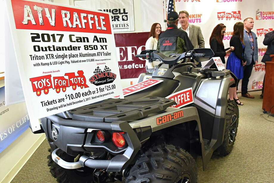 An ATV and trailer will be raffled off as The U.S. Marine Corps Reserve and Dunkin' Donuts launch their annual Toys for Tots campaign on Friday, Oct 13, 2017 in Schenectady, N.Y. The program delivers holiday cheer to children across Upstate New York. (Lori Van Buren / Times Union) Photo: Lori Van Buren, Albany Times Union / 20041840A