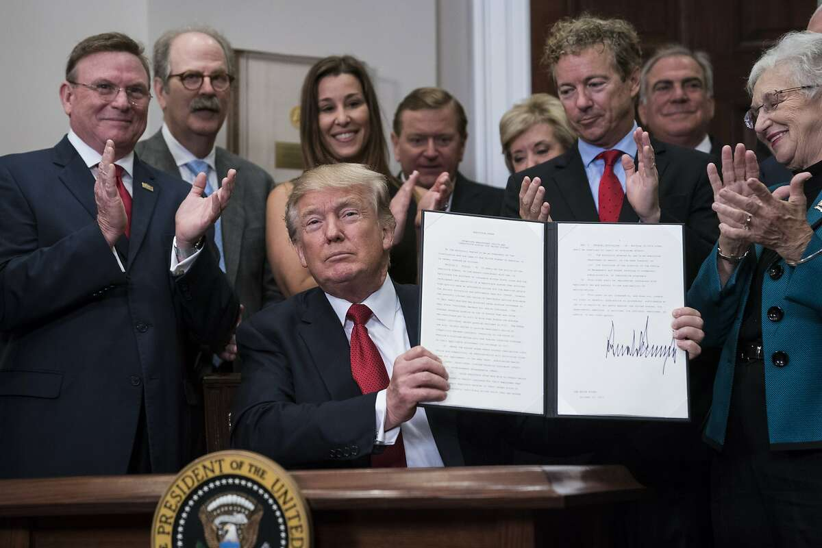 President Trump signs an executive order on health care the White House Thursday. MUST CREDIT: Photo by Jabin Botsford/The Washington Post.