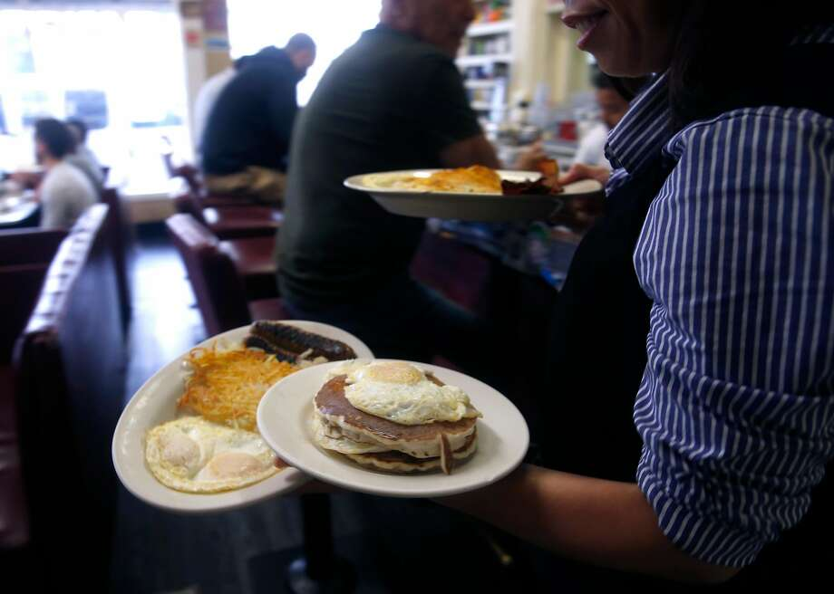 Breakfast plates are served at Eddie's Cafe on Divisadero Street in S.F., which also serves grits. Photo: Paul Chinn, The Chronicle