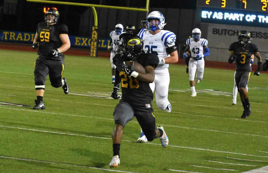 Klein Oak wide receiver/running back Dorian Manuel hauled in a 78-yard touchdown pass from quarterback C.J. Ward, and Ward ran 98 yards for the go-ahead score with 8:52 remaining in the game. Klein Oak rallied past previously undefeated Klein 25-23 on Thursday at Klein Memorial Stadium. Photo: Tony Gaines/ HCN, Photographer