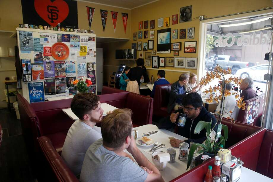 Diners have breakfast at Eddie's Cafe on Divisadero Street in S.F. Photo: Paul Chinn, The Chronicle