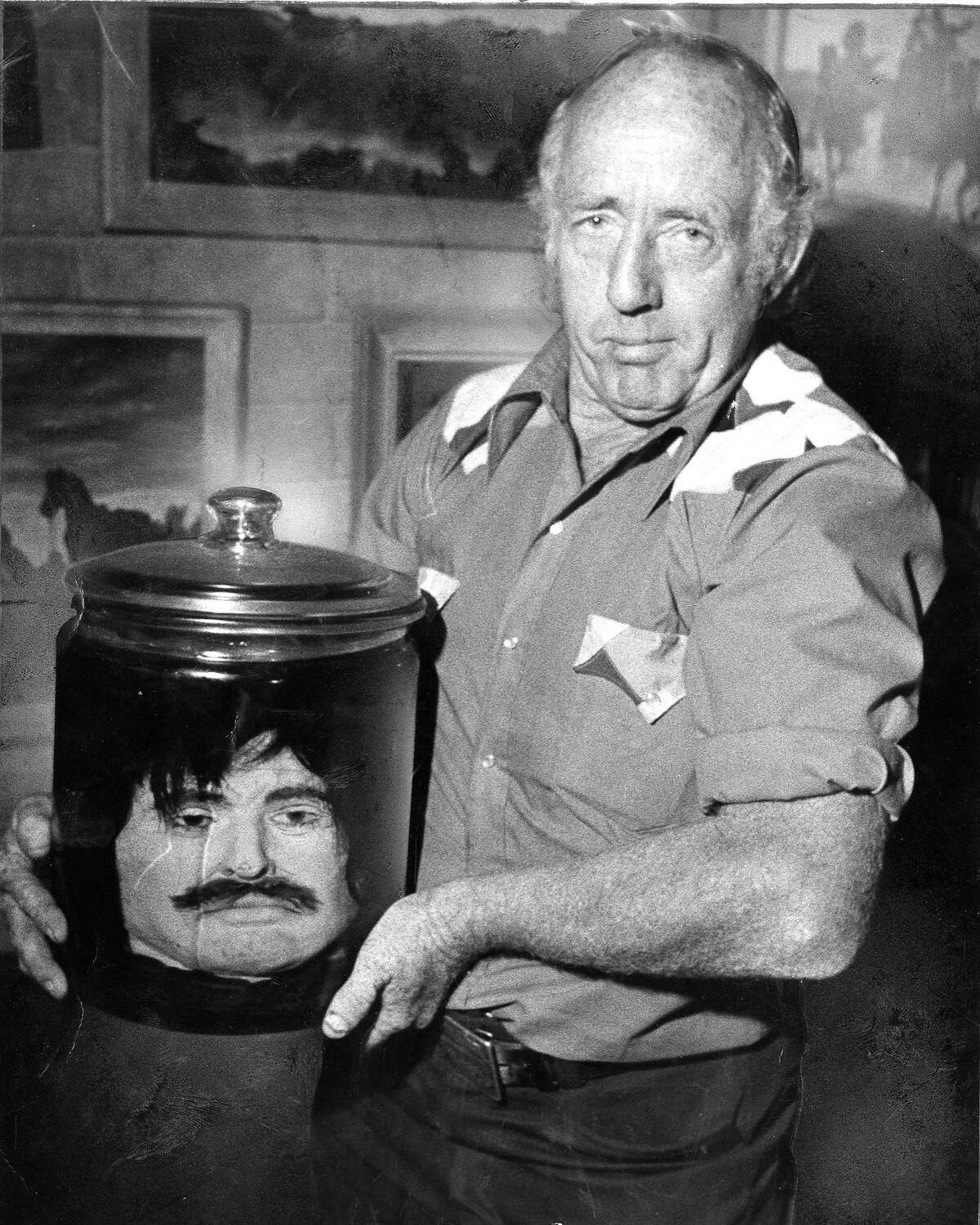 Walter Johnson holds a jar purported to hold the head of Joaquin Murieta , August 7, 1980 Photo ran 08/08/1980, p. 2