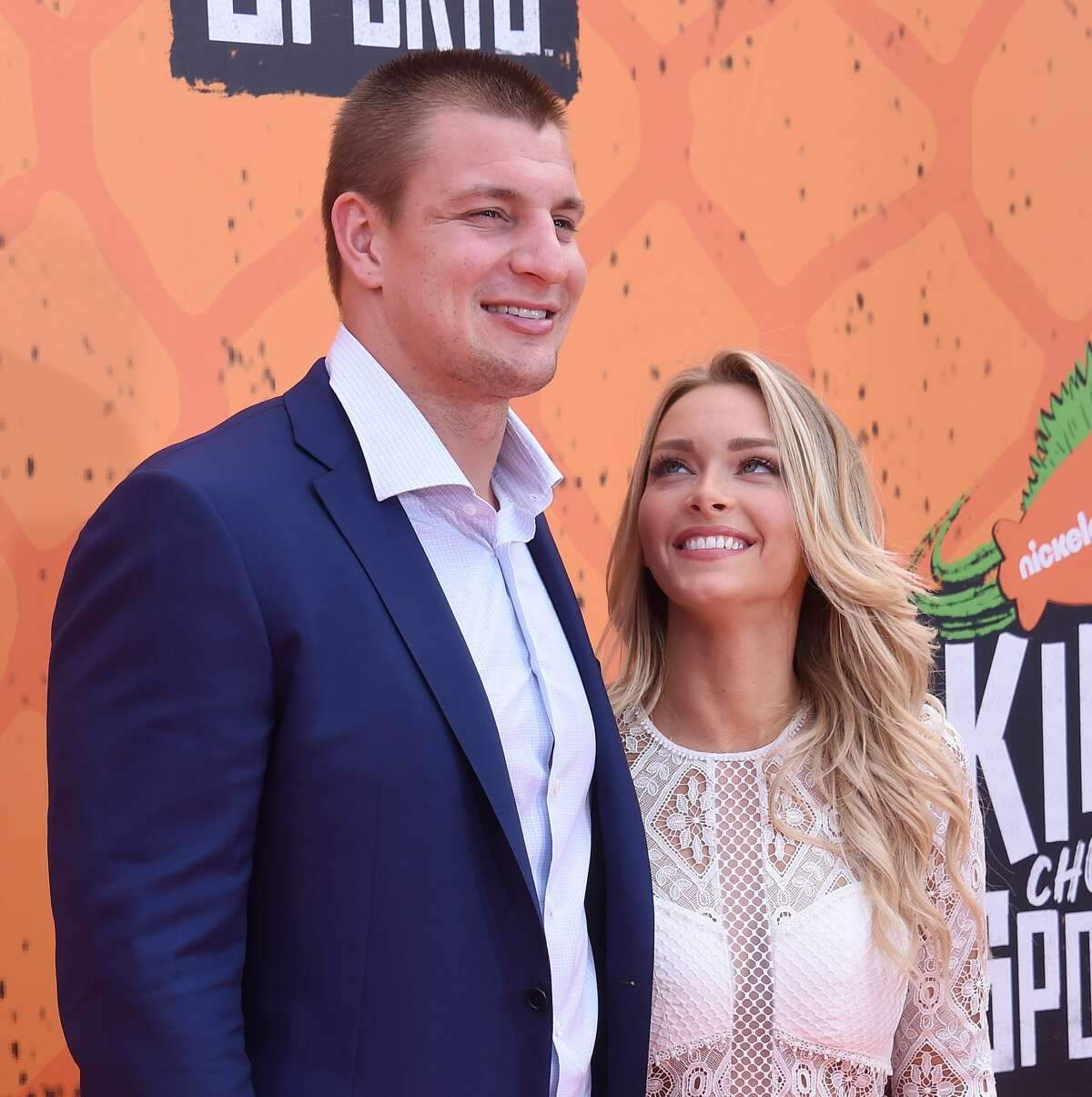 NFL player Rob Gronkowski and Camille Kostek arrive at Nickelodeon Kids' Choice Sports Awards 2016 at UCLA's Pauley Pavilion on July 14, 2016 in Westwood, California.