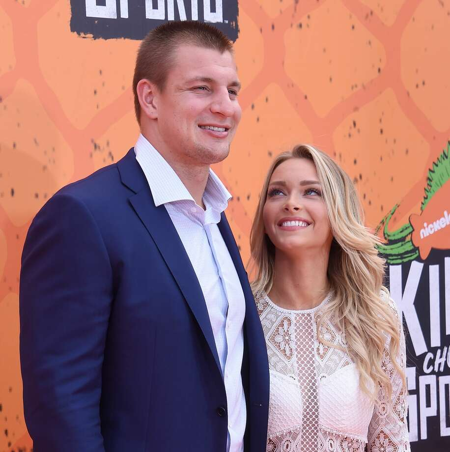NFL player Rob Gronkowski and Camille Kostek arrive at Nickelodeon Kids' Choice Sports Awards 2016 at UCLA's Pauley Pavilion on July 14, 2016 in Westwood, California. Photo: Gregg DeGuire/WireImage