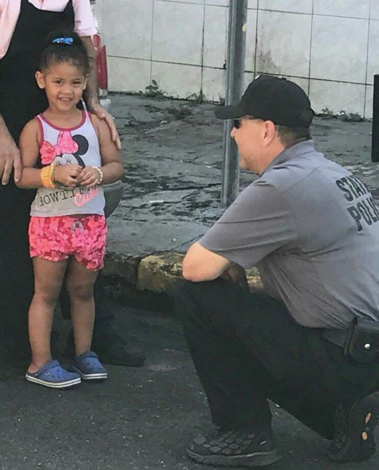 Click through for a slideshow of State Troopers helping out in Puerto Rica after Hurricane Maria. Troop G Zone Sgt. John Bellavigna talk to a little girl while conducting traffic stops in San Juan. Fifty-three troopers arrived in Puerto Rico on Friday, Sept. 29, 2017, to assist with law enforcement and humanitarian aid efforts as the U.S. territory recovers from the devastation of Hurricane Maria. Photo: New York State Police