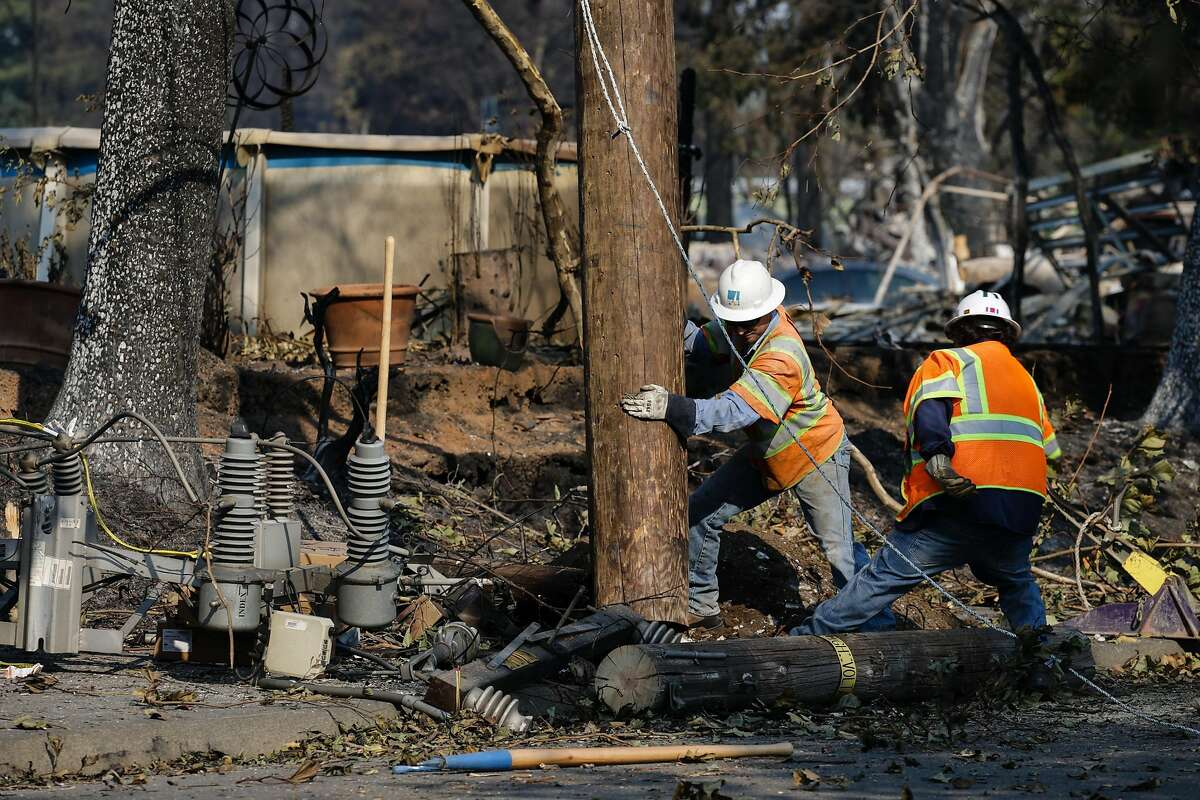 PG&E workers work to repair power lines in the Coffey Park neighborhood following the damage caused by the Tubbs Fire on Oct. 13, 2017 in Santa Rosa, California.