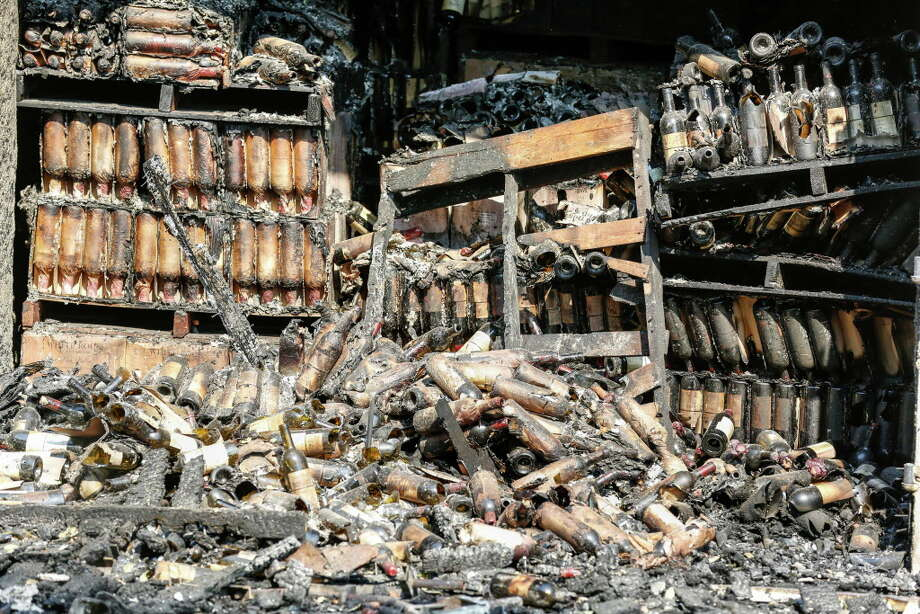Hundreds of wine bottles are damaged and burned from inside the cellar at White Rock Vineyards in Napa, California on October 12, 2017. Photo: Amy Osborne / ONLINE_YES